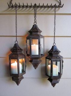 Lanterns hung from old metal rake head.                                                                                                                                                      Plus