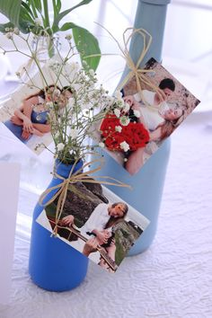 Faça você mesma, garrafas pintadas com tinta spray e usadas para decorar as mesas do casamento. ;)