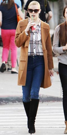 Snapped out and about in Los Angeles, Jaime King stood out in a chic dark camel Leon Max double-weave wool coat over a pale-pink plaid shirt...