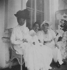 Dowager Empress Maria Feodorovna, holding her great granddaughter, Irina Felixovna Yusupova, in her lap.  Next to her is her granddaughter, and the baby's mother, Irina Alexandrovna, and next to Irina is her own mother, Xenia Alexandrovna.