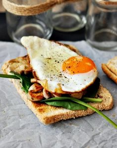 Mushrooms and spinach topped with a sunny side up egg ~ via denØFopulence