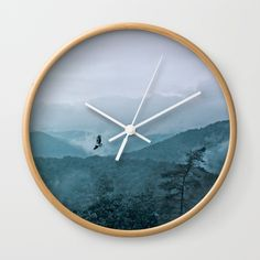 Wall clock Blue smoky mountains by Pirmin Nohr A buzzard is circling over the mountains, while the water of the rain is rising up to the sky again. Animal, nature, landscape, fauna,flora, mountains,trees, blue, clouds, steam, water vapor, aqueous vapor, blue, forest, sky, bird, raptor