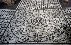 bathroom. mosaic tiles in pattern at exterior edges... from villa adriano at tivoli.
