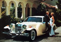 Step away from the car...Now! Classic  Great Gatsby car......buttercream color