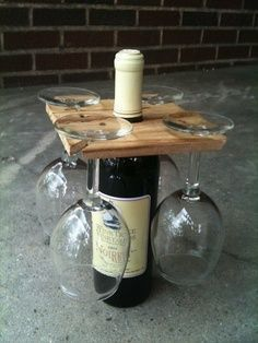 """This handmade wine glass holder sits perfectly on the neck of a wine bottle. It is perfect for a picnic or small """"get togethers"""". Four wine glasses slide into slots in the corners to hang upside down::"""