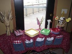 "Julie Parnell found items she had around  the house to help create decor for her sons farm party. Julie describes her party: ""When each kid arrived they were given a farmers straw hat to wear. My grandmother made the tablecloth on the utensil table from material and old jean pockets. The centerpieces were created from..."