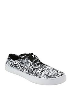<p>For your inner hero! Lace-up canvas sneakers from Marvel with an allover comic print design. True to size.</p>  <ul> 	<li>Canvas upper</li> 	<li>Imported</li> 	<li>Listed in women's sizes</li> </ul>