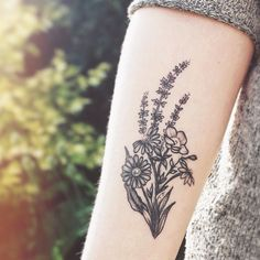 My tattoo done by Rebecca Vincent in Finsbury Park. Lovely wild flowers on my forearm!