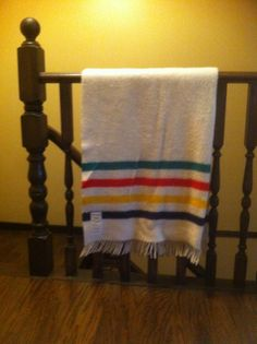 My Hudson's Bay blanket proudly hanging on our new upstairs railing.