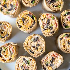 Taco Tortilla Roll Ups are easier than ever AND lightened up! Think Taco Dip in roll up form made with Greek Yogurt and low-carb Flatout flatbread.