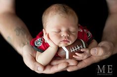 newborn holding football with his daddy. Precious picture! newborn photos, sports themed newborn photos #baby #photography #newborn