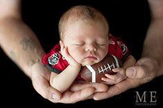 newborn holding football with his daddy. Precious picture! newborn photos, sports themed newborn photos #baby #photography #newborn
