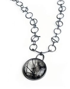 Senay Akin. Pendant: Spellbound Woods, 2007. Routil quartz, sterling silver. 48 cm long. From Tales Series.