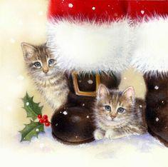.two kittens sitting at Santa's feet