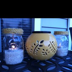 Mason jars with rice and tea lights to match decor. I used citronella tea lights for outdoor use.