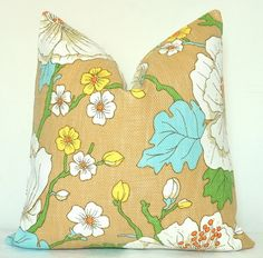 """Pillow cover - not same color way, and different style, but cute. Yellow, green, and orange work with room. Blue would be new. Less """"little girl"""" and more retro than the other styles"""