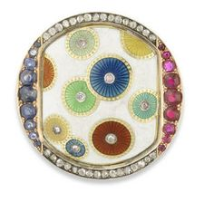 An aesthetic movement gem-set and enamel gold brooch by Fabergé, workmaster Henrik Wigström, St. Petersburg, circa 1900, the central white opaque enamel plaque enriched with vari-colour overlapping diamond-centred enamel disks over guilloché ground within ruby, diamond and sapphire-set mount.