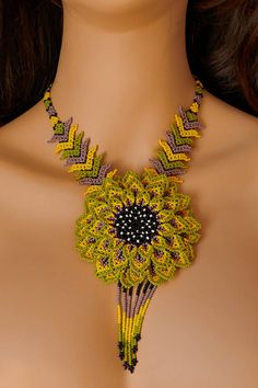Huichol necklace, with multicolor small beads, big flower design! Wear an unique necklace and be unique ! :)