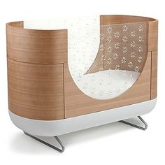 The Pod Crib from Ubabub surrounds your baby in comfort and style with its cocoon shape. A modern take on bedding for your child, clear acrylic sides have star cut-outs to make checking on your little one easy. Converts to a toddler bed (kit included).