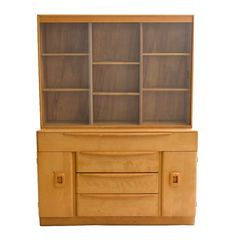 A Mid Century Modern Heywood-Wakefield buffet and hutch in maple with a wheat finish. Includes a hutch with shelving and glass sliding doors which sits on top of a buffet having three drawers and t. Sliding Glass Door, Sliding Doors, Sit On Top, Media Center, Mid Century Modern Furniture, China Cabinet, Shelving, Wakefield, Mid-century Modern