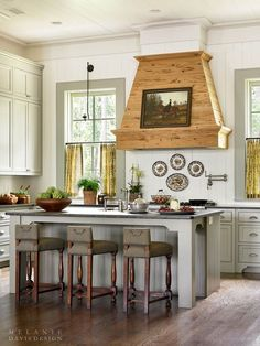 Country kitchen with shiplap walls and a custom wooden hood over the stove in a home located near Midland Georgia. [1135 1512]