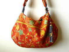 "From etsy shop ""fairly worn"", a  bag made from a vintage Kantha quilt---a special fabric made in India by hand-stitching together layers of old cotton saris.     Gorgeous example!"