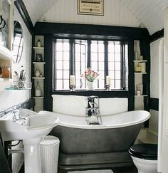 Okay, add a slanted ceiling and we are closer to my bath, how about a fake window beside the tub that is shelving inside it... 23 Traditional Black And White Bathrooms To Inspire | DigsDigs