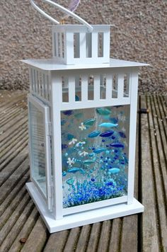 A functional lantern incorporating our Cornflower design. The lanterns can be used indoor or outdoor. 3 of the sides have decorated sides with the cheerful colourful blue flowers which when lit up with either a candle or fairy lights inside give a lovely glow to any room. The lantern is 28cm (H) , 15cm (D) x 15cm (L) Please note candles and fairy lights are not supplied with the item.