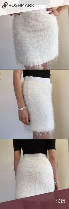"""UO *Kimchi Blue* Sparkle & Fringe White Mini Skirt Urban Outfitters *Kimchi Blue* Sparkle & Fringe Mini Skirt White all over fringe w/ sparkles Sparkly silver, elastic waistband Fully lined skirt Skirt 💯% Poly/Lining 98% Poly 2% Spandex 🌟Like New/Excellent Condition🌟 Only flaw is blacked out brand on label Size M but will fit a S/M This skirt is so fashionable yet comfortable. Perfect for a holiday party or a girls night out! 💜I️ am the model: I️ am 5"""" and wear an XS/S💜 🚭Smoke-free…"""