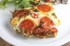 The best Pizza Casserole recipe made with all your favorite pizza toppings into a delicious and comforting casserole. Low carb and keto friendly.