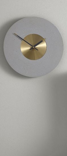 Birgen Wall Clock, in grey and brass, £29 MADE.COM With the industrial look making a resurgence, it's easy to see why fans of this movement are so crazy for concrete. We've recreated this tough-luxe look in the Birgen wall clock.