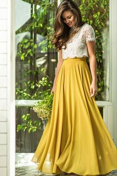 This maxi skirt is all you could have asked for and more! With flowy layers, a flattering silohuette and gorgeous yellow-chartreuse color, this skirt is bright essential for your wardrobe. Just take a #Yellow