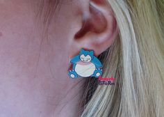 A must have for any Pokemon Fan. These Snoozing Snorlax earrings are adorable and look so cute on, they appear to be taking a little nap in your Pokemon Fan, Pokemon Stuff, Front Back Earrings, Cute Little Things, Cute Earrings, Nerdy, Ideias Fashion, Halloween Costumes, Geek Stuff