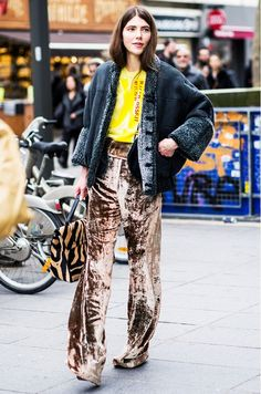 Velvet pants and a yellow blouse are paired with an animal print bag and black wool jacket.