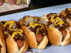 Hot Wieners Rhode Island Style : Guy smothers hot dogs in a sauce of beef simmered with onions and spices. via Food Network. Hot Dog Recipes, Beef Recipes, Cooking Recipes, Wing Recipes, Sausage Recipes, Hot Dog Chili, Chili Dogs, Hot Weiners Recipe, Pastries