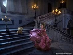 "Nelle Rossi running down the stairs in a scene from ""Beauty and the Beast."""
