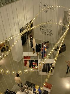 Hundreds of golden Work Lamps at H&M in London.  Work Lamp is designed by Form Us With Love for Design House Stockholm