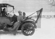 RUSSIAN REVOLUTION OVERTHROW TSAR MARCH 1917 (Q 69408) Two Russian soldiers travelling on the footboard of a motor car, red flags affixed to their bayonets during the revolution in Petrograd.