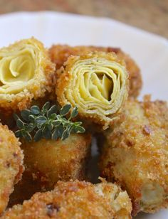 Breaded Artichoke Hearts- I would just add some cream cheese in the middle & use a marinara to dip! YUM