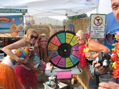 Every luau needs a Prize Wheel. Buy this Prize Wheel at http://PrizeWheel.com/products/tabletop-prize-wheels/tabletop-black-clicker-prize-wheel-12-slot/.