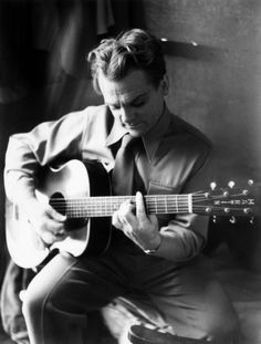 James Cagney: Yeah! Didn't know he could play guitar, did ya!  Looks like he knew what he was doin' too!