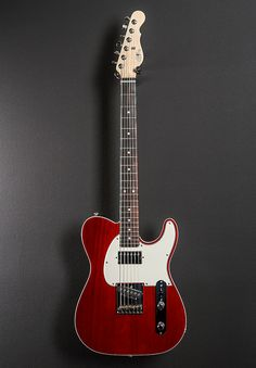 Clear Red top with a Natural back, Swamp Ash top with the optional deleted F hole and binding on a Black Limba body, Optional Parchment pickguard, Modern Classic shaped. Fender Stratocaster, G&l Guitars, Black Acoustic Guitar, Guitar Photos, Stereo Amplifier, Guitar Shop, Pedalboard, Modern Classic, Bass