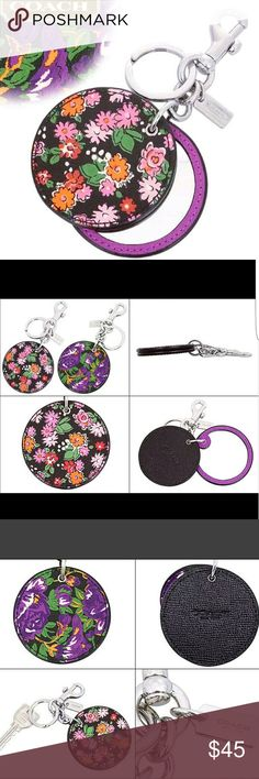 """Floral Mirror Bag Purse Keychain Ring Clip Charm New with Tags! FLORAL DISC MIRROR BAG CHARM COACH F58500 SILVER/STRAWBERRY HYACINTH  (Double sided patterns as shown in photos -- each side of the keychain is a different pattern *purple & green on one side; pink & multi colors on the other side*)  Details: Printed coated canvas Interior mirror 2 1/2"""" (L) x 2 1/2"""" (H) 1 1/4"""" attached split key ring and carabiner clip Silver hardware MSRP:$60  No trades please. Will ship right away. Smoke & Pet…"""