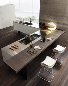 Minimalist Kitchen //the perfect balance of a modern white kitchen with a rich wood bar / casual eating counter // via MODULNOVA project 16 Kitchen Dinning, Kitchen Nook, New Kitchen, Kitchen Decor, Kitchen Rustic, Stylish Kitchen, Kitchen White, Kitchen Small, Dinning Table