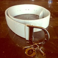 """Christian Dior belt  authentic Christian Dior Cannage leather belt. Belt is in great condition, has been worn only a handful of times. Only signs of wear can be seen on the belt holes where it was buckled. No cracks, scratches or scuffs on leather. Silver D buckle hardware with dangling """"ior"""" letters. Size 80. Will fit anyone who wears a medium size or pant sizes 5-7 Dior Accessories Belts"""
