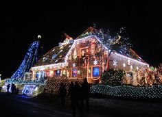From Christmas carnivals on the lawn to grand light shows synchronized to holiday music, these 15 houses decked out with over-the- top decor and lighting provide shining examples of how to ring in the holidays with panache. Best Christmas Lights, Hanging Christmas Lights, Christmas Light Displays, Holiday Lights, Outdoor Christmas, Christmas Diy, Merry Christmas, Christmas Light Installation, Christmas Carnival