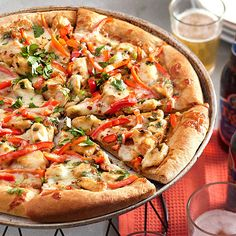 This tasty Thai Chicken Pizza is topped with chicken, red sweet pepper, green onion and mozzarella cheese. More healthy chicken recipes: http://www.bhg.com/recipes/healthy/dinner/healthy-chicken-recipes/?socsrc=bhgpin072813thaipizza=19