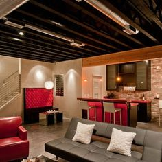 industrial feel basement - maybe exposed pipes would make the basement ceiling seem higher?