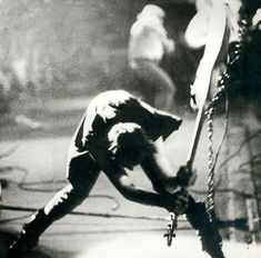 "Famous image of Simonon smashing his Fender Precision Bass against the stage at The Palladium in New York City on September 21, 1979 during the ""Clash Take the Fifth"" US tour. Photograph by Pennie Smith"
