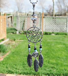 Rear View Mirror Accessories ... This dreamcatcher features a 10mm clear lead crystal bead, oxidized silver toned metal feathers, bear fetish bead, and dream catcher connector. This car charm can easily attach to your rearview mirror with the 6 ball chain thats included. This piece measured from the top of the bail to the bottom of the longest feather is 4 3/4 long, and its 1 1/8 wide at the widest point.  This item will ship by First Class Parcel.  *********************************...